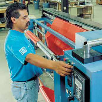 Armand Manufacturing, Inc. Employee with Production Machinery